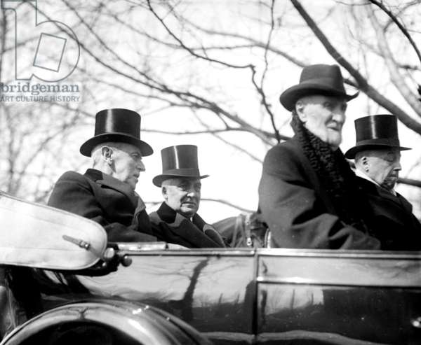 Incoming President Warren G. Harding (1865-1923) riding in open convertible to his inauguration with Presidential Woodrow Wilson (1856-1924), March 4, 1921. In front seats are Joseph Cannon and Philander Knox