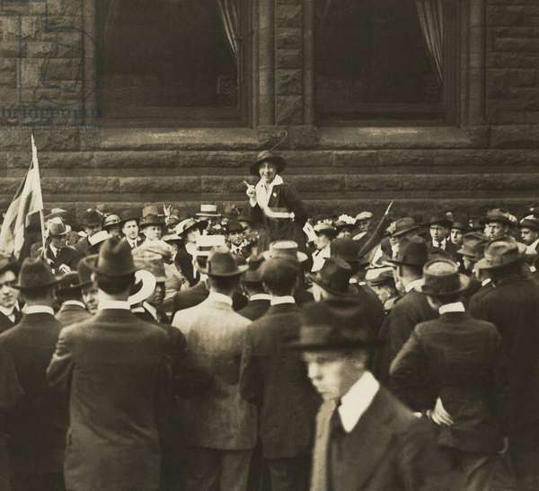 Suffragist Mabel Vernon speaking to large crowd of men an Open-Air Meeting in Chicago. In addition to her gifts as a speaker for the National Women's Party, she organized demonstrations and was herself arrested and imprisoned in 1917
