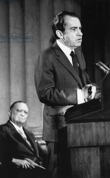 1971 US Presidency. FBI Director J. Edgar Hoover (background) watches as President Richard Nixon delivers speech at the FBI National Academy graduation exercises, Washington, D.C., 1971