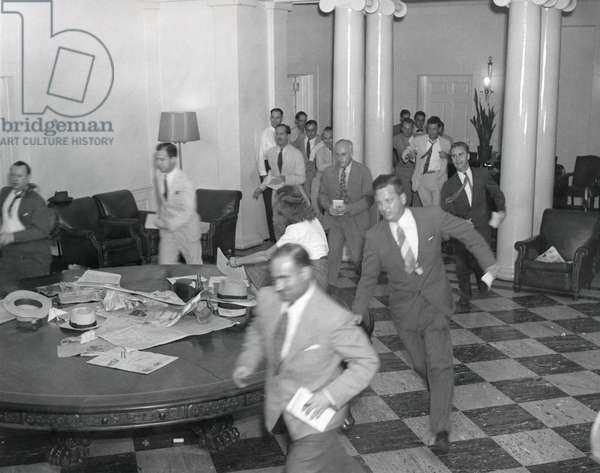 Reporters running through the White House after the announcement of Japan's surrender, ending WW2. August 14, 1945. - (BSLOC_2014_15_20): Reporters running through the White House after the announcement of Japan's surrender, ending WW2. August 14, 1945. - (BSLOC_2014_15_20)