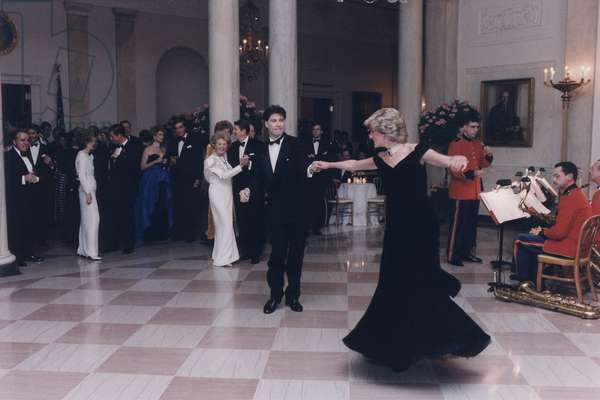 Princess Diana dancing with John Travolta after a White House dinner for the Prince and Princess of Wales. Nov. 9 1985