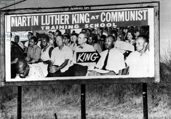 A billboard in Selma, Alabama, on U.S. 80, the highway over which 300 civil rights marchers, led by Dr. Martin Luther King Jr., are enroute to Montgomery to seek an audience with Governor George Wallace. The text reads: 'Martin Luther King at Communist Training School'. March 22, 1965.