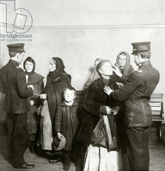 Physical examination of female immigrants at Ellis Island, New York City. The doctor is checking for trachoma, a highly contagious and difficult to cure eye disease. 1911