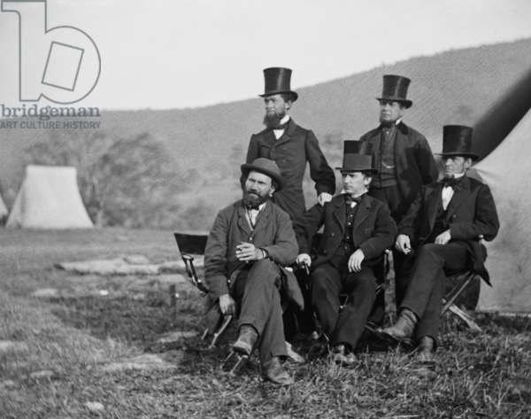 Major Allan Pinkerton, head of the Union spy agency called 'The Secret Service' with four top hatted gentlemen, at Antietam, Oct. 3, 1862. The men are identified in the original caption as: Messrs. Allan Pinkerton, Hammond, Fargo, and Hall. Pinkerton led the Secret Service Department of the Army of the Potomac. US Civil War photo was taken by Alexander Gardner, during President Lincoln's post-battle visit to Gen. George McClellan