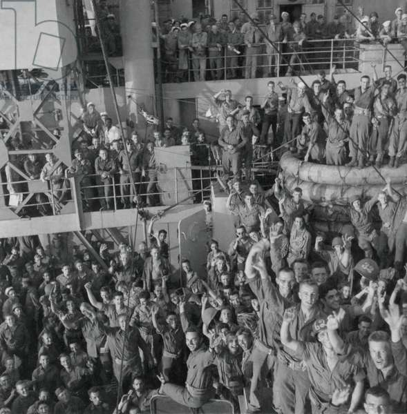 Soldiers of the U.S. 143rd Infantry cheer Italy's unconditional surrender to Allied Nations. The Italian government surrended on Sept. 6, 1943 three days before the Allied landings on the Gulf of Salerno, south of Naples, Italy. World War 2