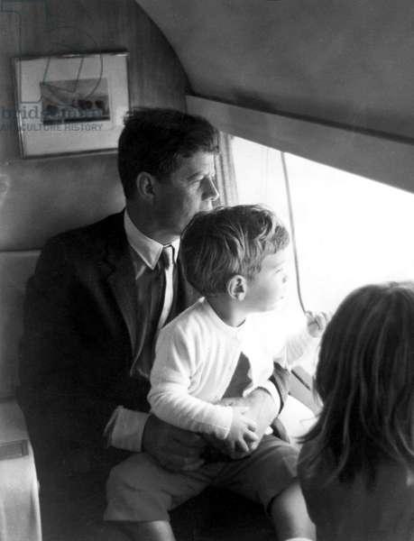 JOHN F. KENNEDY and his children, John Jr. and Caroline. Undated.
