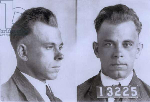 John Dillinger (1903-1934), in mugshot probably made during his eight and half year term in Indiana State Prison. Dillinger was played by actor Warren Oates in the 1973 movie DILLINGER, and by Johnny Depp in 2009 film, PUBLIC ENEMIES. c. 1925