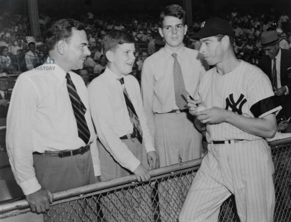 Joe Di Maggio autographs baseball for Gov. Thomas Dewey's sons, Tommy and Johnny. 1948.