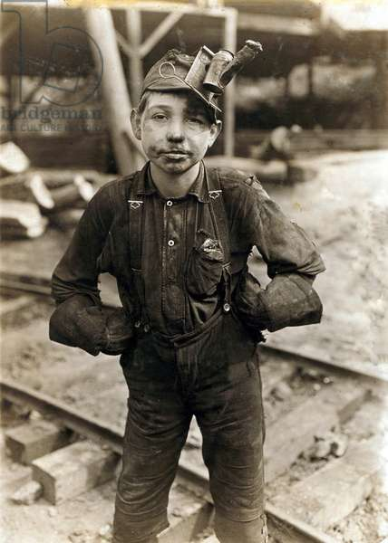 Child laborer portrayed by Lewis Hine in 1908. Tipple Boy at West Virginia coal mine, worked with the tipple, a device that tilted coal cars from the mine for unloading