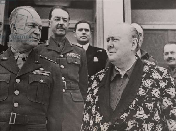 General Eisenhower, General Harold Alexander, allied commander-in-chief in Italy, and Prime Minister Winston Churchill, in 1944. Churchill wears a dressing gown because he was recovering from an illness