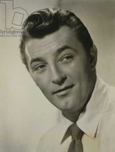 Robert Mitchum (1917-1997), popular American actor in publicity portrait of 1952