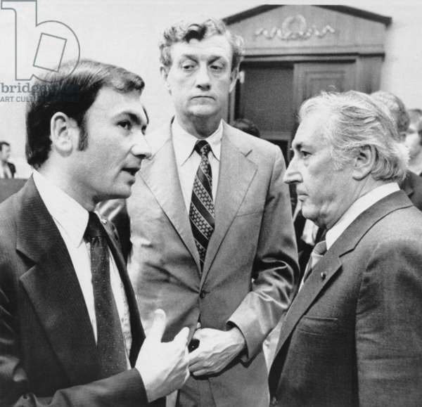 Richard Nixon. Representative Peter Rodino (right), chairman of the House Judiciary Committee, confers with chief impeachment counsels Sam Garrison (left) and John Doar (center), after the committee's first session of debate on the possible impeachment of President Nixon. Washington, DC, July 25, 1974