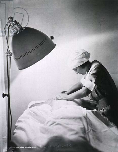 Nurse giving back rub to a patient in Walter Reed General Hospital. 1922