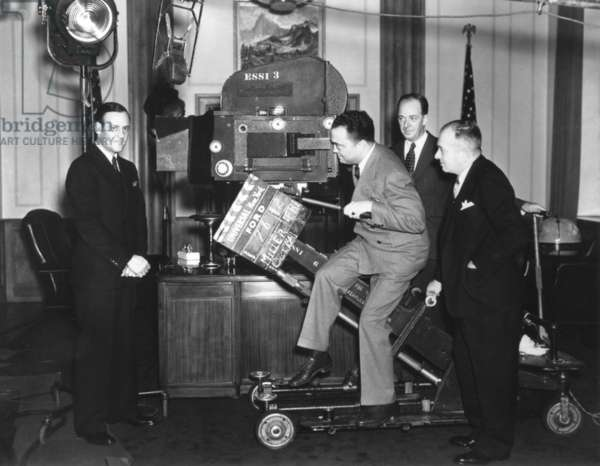 FBI Director J. Edgar Hoover with a Newsreel camera at Universal Studios. Clyde Tolson, Hoover's FBI colleague and personal companion is on far left. c. 1935-40
