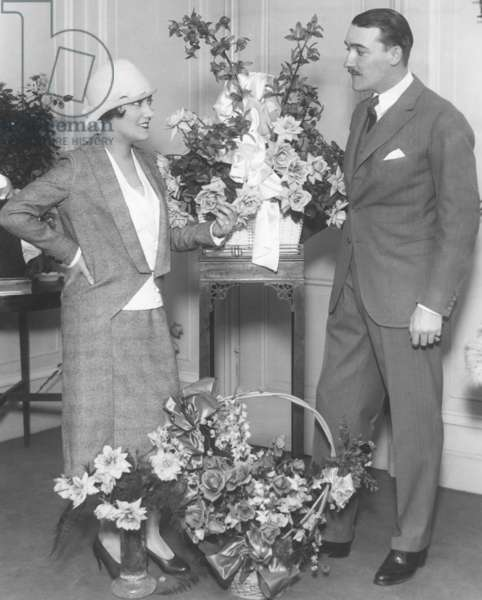 Newly married Gloria Swanson and Marquis de la Falaise, at the Ritz Carlton Hotel in New York City. Many floral pieces greeted her return from France in Nov. 1923