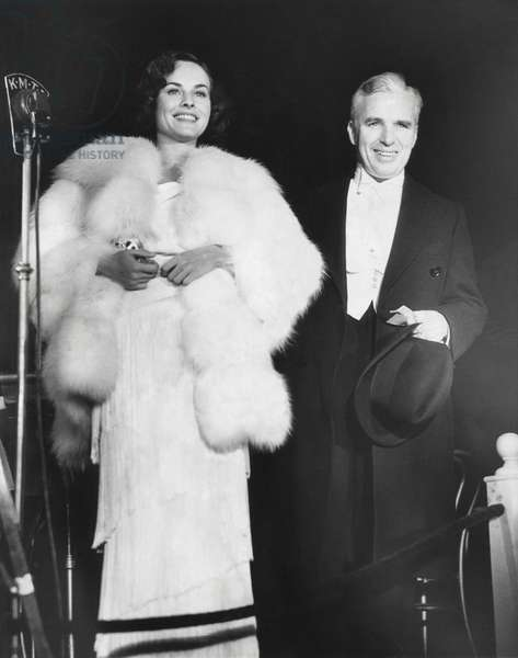 Charlie Chaplin attends the premiere of MODERN TIMES with his leading lady, Paulette Goddard. The film had no dialogue but employed sound effects and was a big success. Hollywood Chinese Theater, Feb. 15, 1936.