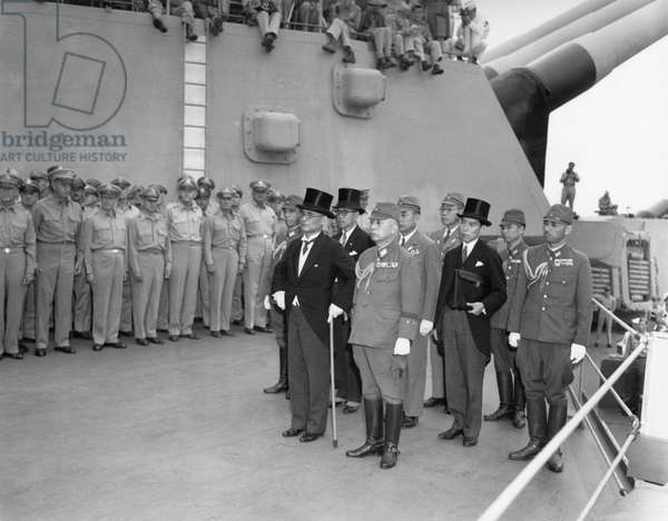 Japanese surrender signatories arrive aboard the USS MISSOURI in Tokyo Bay. Japanese Foreign Minister Mamoru Shigemitsu, in front with top hat, would sign the surrender. Sept. 2, 1945. World War 2
