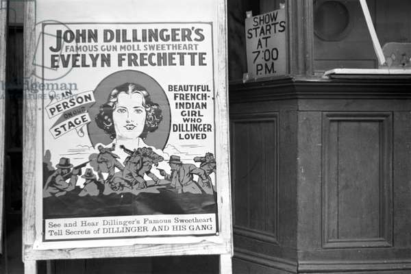 Movie theatre in Hillsboro, sandwichboard advertising an appearance by Evelyn Frechette, North Carolina, April, 1938 (b/w photograph)