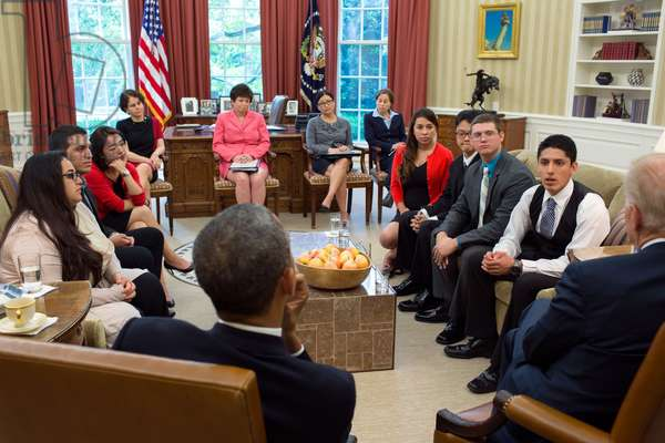DREAMers recipients of Deferred Action For Childhood Arrivals (DACA) Initiative in the Oval Office. The children of undocumented immigrants meet with President Barack Obama and Vice President Joe Biden, May 21, 2013. In background are: Cecilia Munoz, Domestic Policy Council Dir.; Senior Advisor Valerie Jarrett; Julie Chavez Rodriguez, Associate Dir. Office of Public Engagement; Kate Kahan, Legislative Dir. For the Center for Community Change,