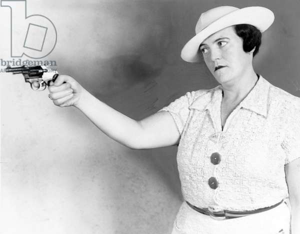 Mary A. Shanley, New York City detective, holding service revolver