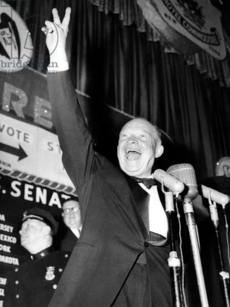 General Dwight D. Eisenhower flashes a victory sign at his Hotel Commodore campaign headquarters after winning the presidential election, November 5, 1952