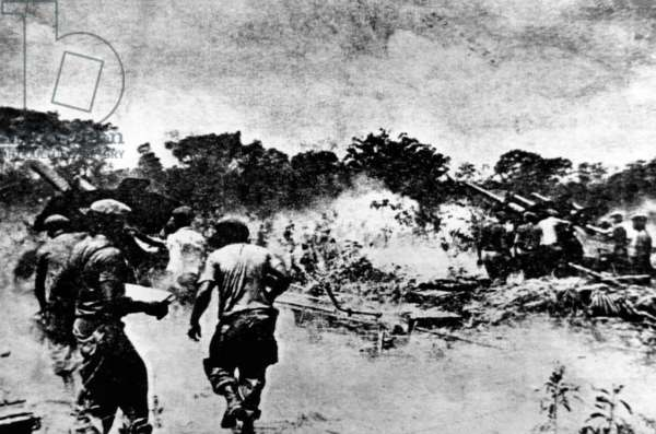 Bay of Pigs Invasion, April 25, 1961. This photograph appeared in the Cuban newspaper 'Revolusion'. It shows large artillery pieces firing on Cuban rebels as they invade a beachhead in Cuba