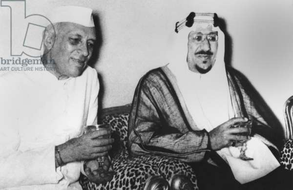 India's Premier Jawaharlal Nehru (left) and Saudi Arabia's King Saud discuss the Suez Crisis. Riyaih, Saudi Arabia. Oct. 1, 1956. In a joint statement at the end of the visit, both opposed economic reprisals against Egypt