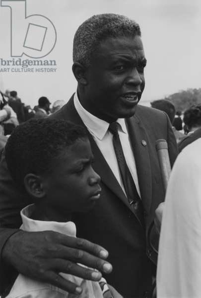 Baseball player Jackie Robinson with his son at the 1963 Civil Rights March on Washington. Aug. 28, 1963