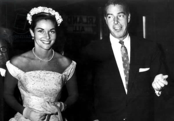 Lee Ann Meriwether, Miss America of 1954, and Joe DiMaggio attend the opening performance of Judy Garland's All-Star Variety Show in New York, 1956
