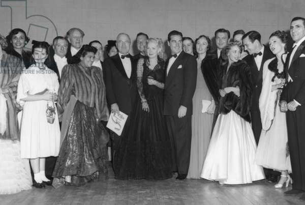 President Harry Truman poses with performers of the inaugural gala held at the National Guard Armory. Jan. 19, 1948. L to R: Lena Horne, Margaret O'Brien, George Jessel, no ID, Dorothy Maynor, no ID, no ID, President Harry Truman, Phil Harris, Alice Faye, Phil Regan, no ID, Lucy Monroe, no ID, no ID, Jane Powell, Gene Kelly, Sally De Marco, Tony De Marco.