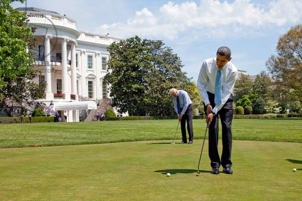 President Barack Obama and Vice President Joe Biden practice their putting on the White House putting green April 24 2009.,