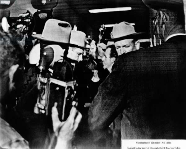 Warren Commission Exhibit. Television screen shot of suspected JFK assassin being moved through third floor corridor of the Dallas Police Station. Nov 22-24, 1963