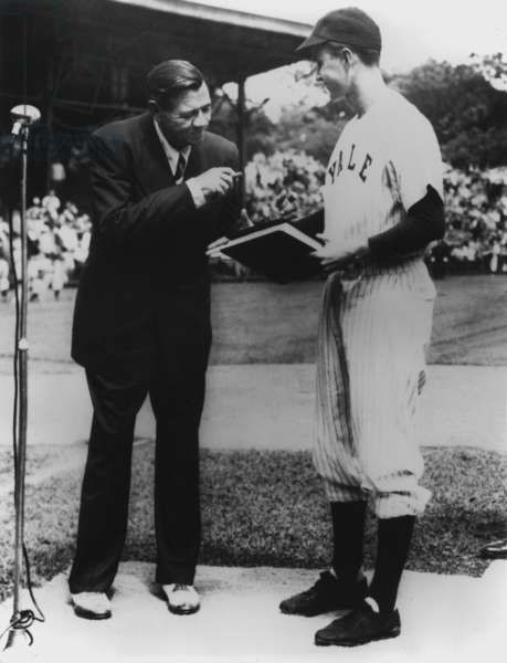 On behalf of Yale University Yale Baseball Captain George Bush accepts the manuscript of THE BABE RUTH STORY his autobiography from Babe Ruth. 1948