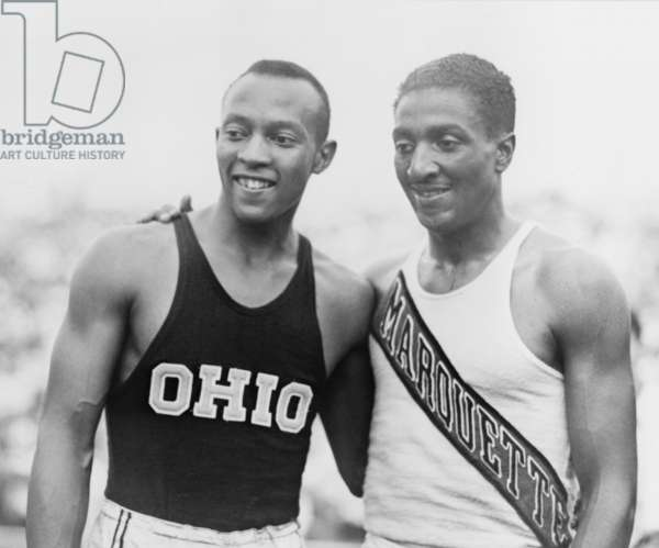 Jesse Owens (1913-1980) with Ralph Metcalfe (1910-1938) teammates and rivals at the 1936 Berlin Olympics. Between them, they won a total of five gold medals in Berlin