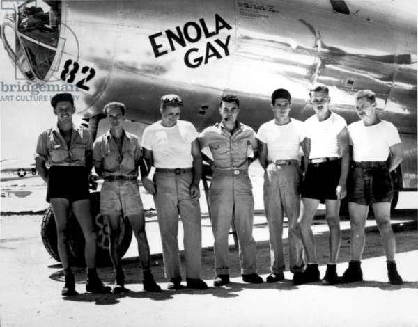 """Enola Gay. The ground crew of the B-29 """"Enola Gay"""" which atom-bombed Hiroshima, Japan. Col. Paul W. Tibbets, the pilot is the center. Marianas Islands. 1945"""