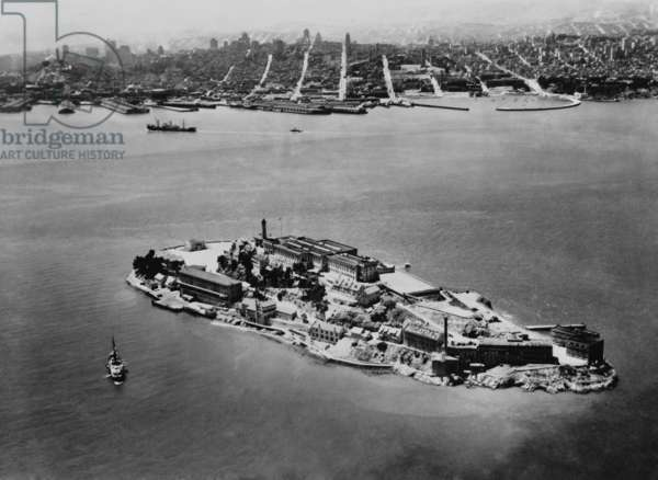 Alcatraz Federal Prison in San Francisco Bay, California, 1938. In the distance is the city of San Francisco