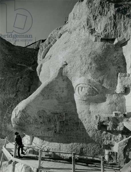 Gutzon Borglum inspects Thomas Jefferson's face at Mount Rushmore, c. 1935. Photo by Charles d'Emery