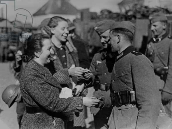 Soldiers receive gifts from Austrian women after the Anschluss, 1938