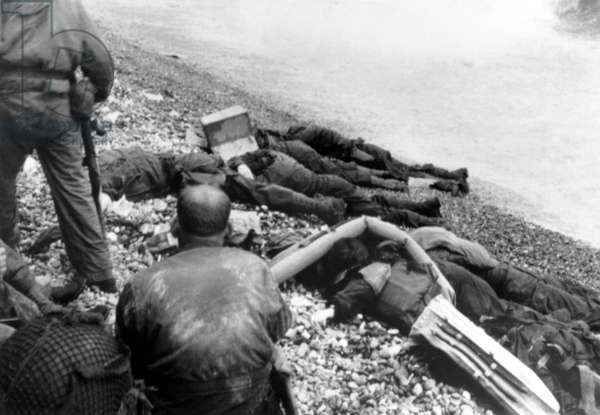 Dead U.S. soldiers Omaha beach on D-Day, June 6, 1944. Some bodies are covered with lifebuoys, and one of them has the face covered by a cardboard box. Normandy invasion, World War 2