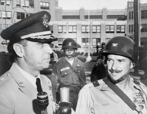 General Edwin Walker (left) with Col. William Kuhn outside Central High School, Little Rock. Sept. 25, 1957. They commanded the 327th Airborne Battle Group, enforcing racial integration. Walker was known for his right wing politics, and resigned his commission in 1961. October 1962, Walker was arrested for leading riots at University of Mississippi protesting admittance of a black student, James Meredith