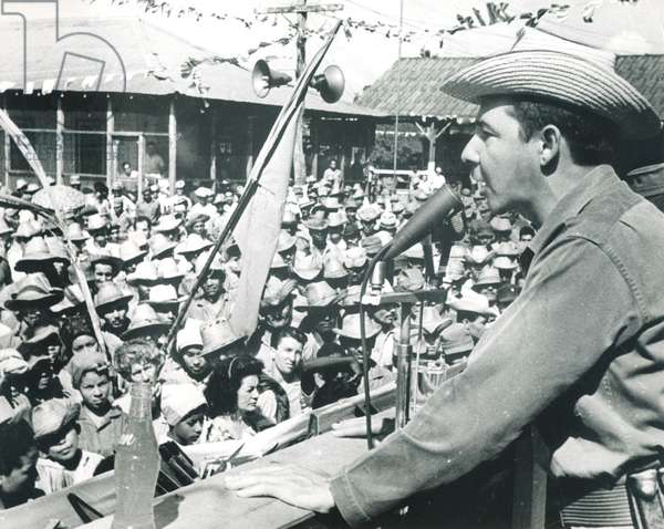 FIDEL CASTRO's brother RAUL CASTRO speaking as Minister of the Revolutionary Armed Forces to sugar refinery workers, urging them to increase the production of the cane crop, c. 1964