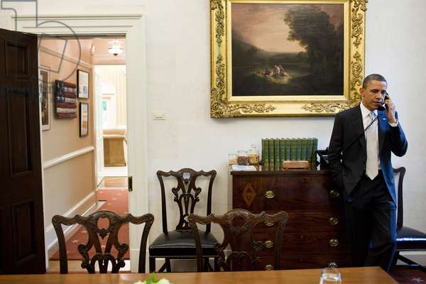 Barack Obama: President Barack Obama talks with Mississippi Governor Haley Barbour about severe storms and tornados that moved across the southeast, during a phone call in the Oval Office Private Dining Room, April 28, 2011.