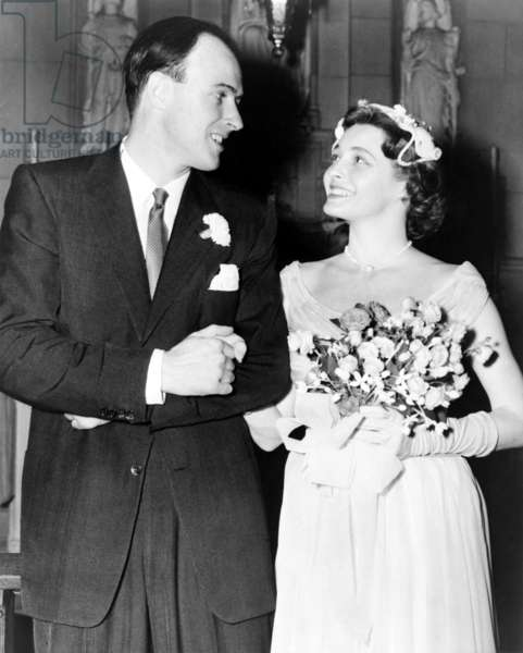 Patricia Neal (b. 1926) and Roald Dahl (1916-1990), smiling at each after their wedding in 1953