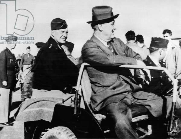 Lieutenant General George S. Patton (extreme left), General Dwight G. Eisenhower (left of center), President Franklin D. Roosevelt, during a visit to Sicily, following the Cairo and Teheran conferences, Italy, December 14, 1943