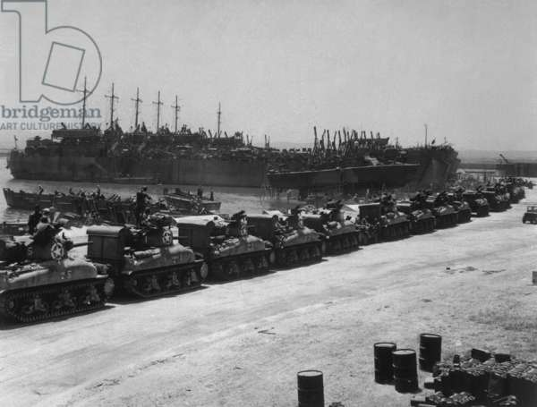 Two days before the Allied invasion of Sicily, tanks board landing craft. Ships are at the French Naval Base, La Pecherie, Tunisia. July 1943, World War 2