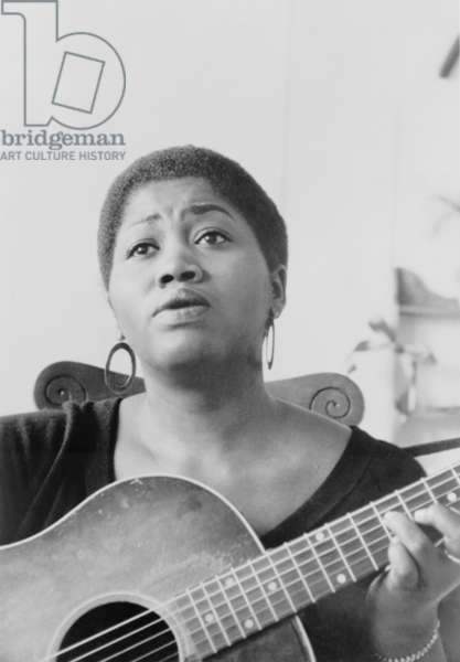 Odetta Holmes (1930-2008), African American folk and blues singer was called 'The Voice of the Civil Rights Movement.' c. 1965