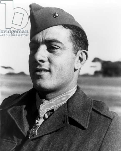 John Basilone, a Marine Gunnery Sergeant with his Medal of Honor, won in the Battle of Guadalcanal. He held off 3,000 Japanese troops during the Battle of Henderson Field, on Oct. 23-26, 1942