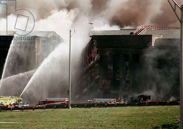 Firefighters struggle to contain the fire after the September 11 2001 terrorist attack on the Pentagon. 64 passengers of American Airlines Flight 77 and 125 others were killed., Photo by:Everett Collection