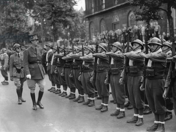 General Charles de Gaulle, inspecting Free French Forces during Bastille Day ceremonies in London. July 14, 1940.