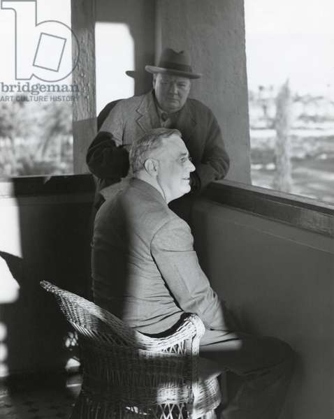 Franklin Roosevelt and Winston Churchill after the Casablanca Conference. Jan.24, 1943. They relaxed there for two days in Marrakesh. Photo shows them watching the sunset on the snows of the Atlas Mountains from a tower